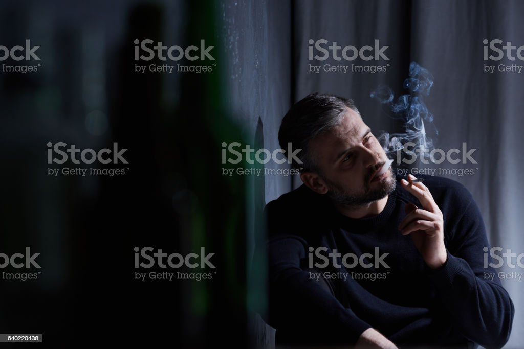 Man addicted to smoking stock photo