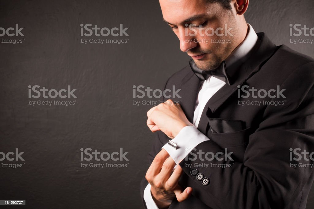 Man Adjusting Cufflink stock photo