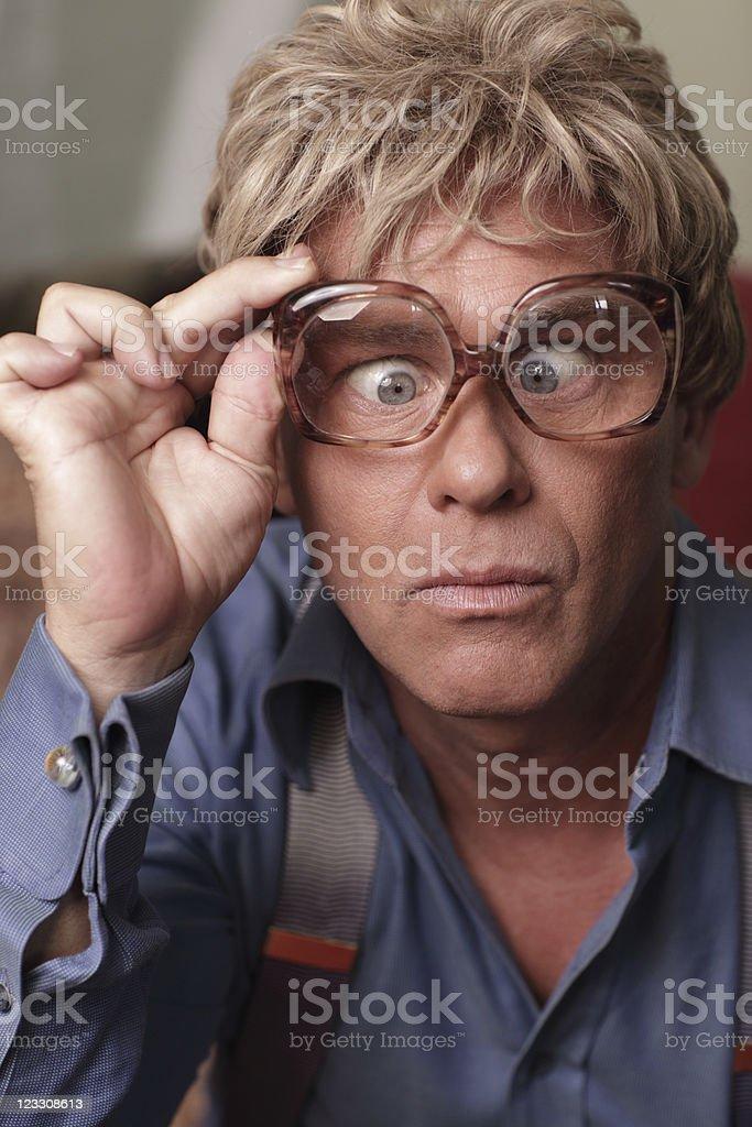Man adjusting his oversized glasses royalty-free stock photo