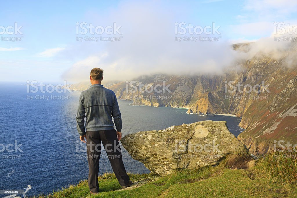 man admires a beautiful landscape stock photo
