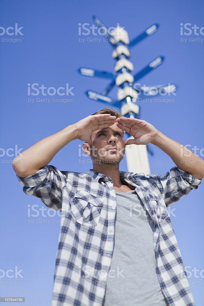 Man admiring view at crossroads stock photo