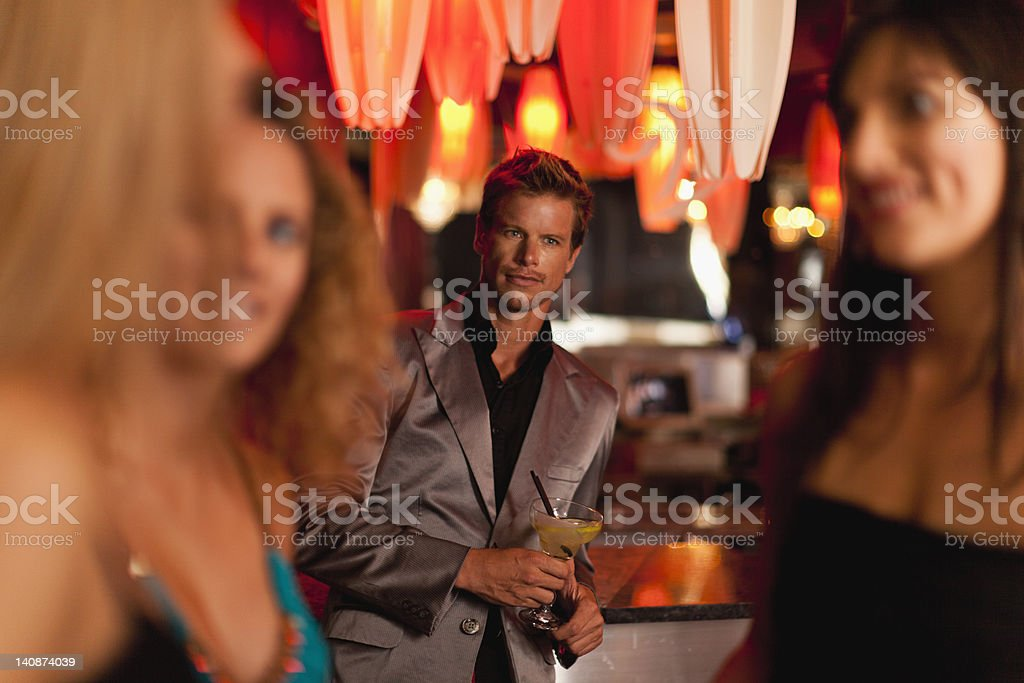 Man admiring women in bar stock photo