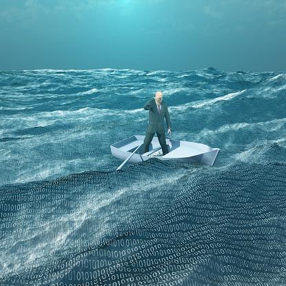 istock Man Adrift in tiny boat in binary ocean 466169430