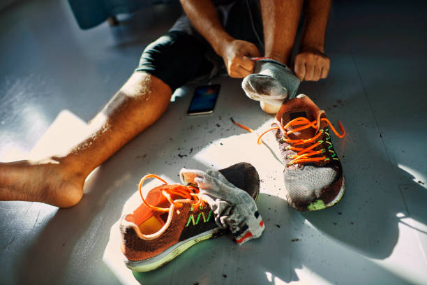 man after a workout - dirty shoes stock photos and pictures