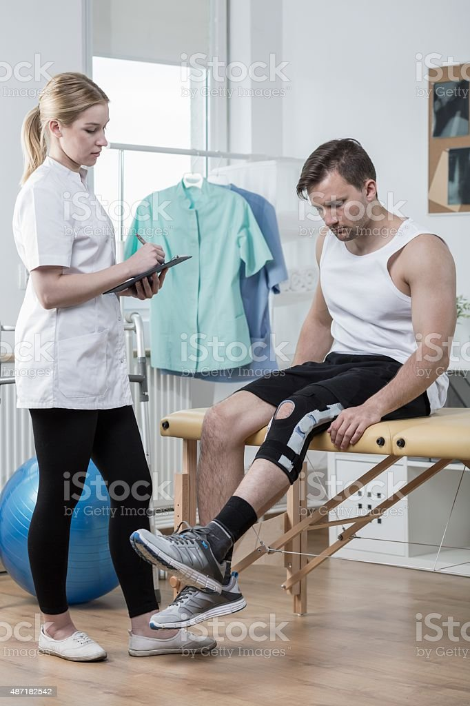 Man after knee ligament injury stock photo