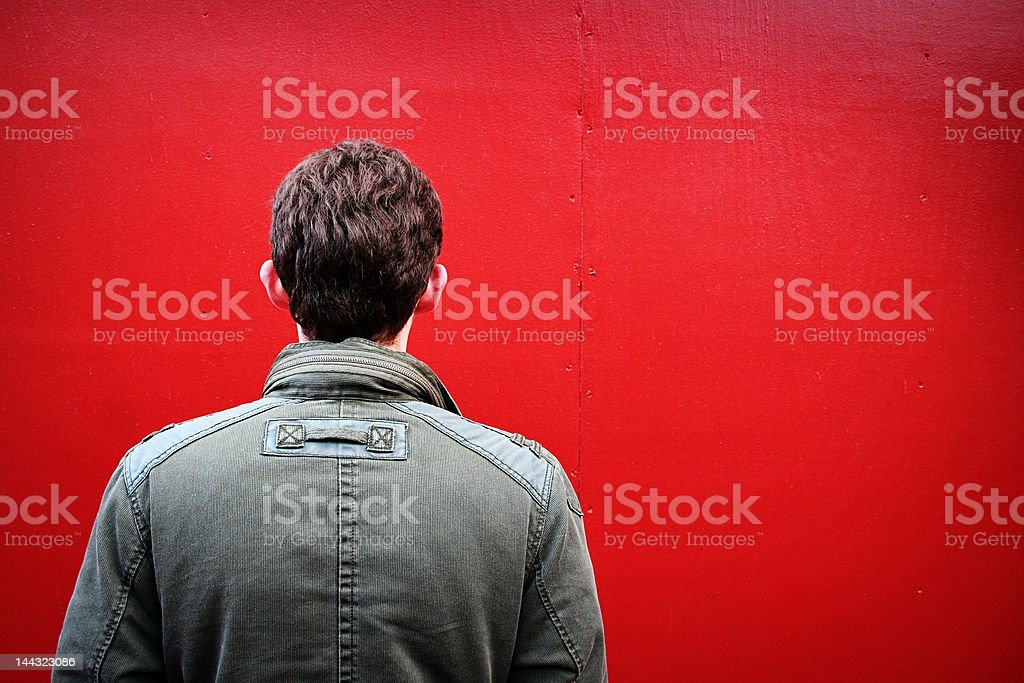 Man Against a Red Wall stock photo