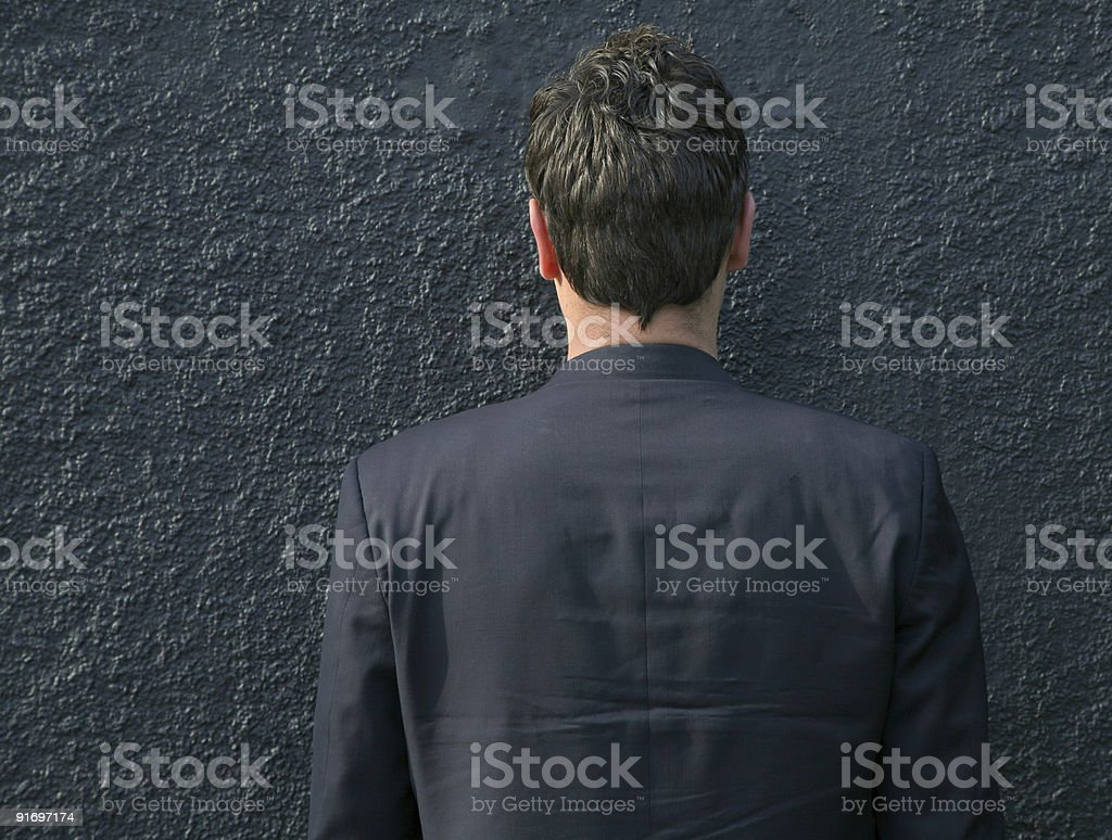 man against a wall stock photo