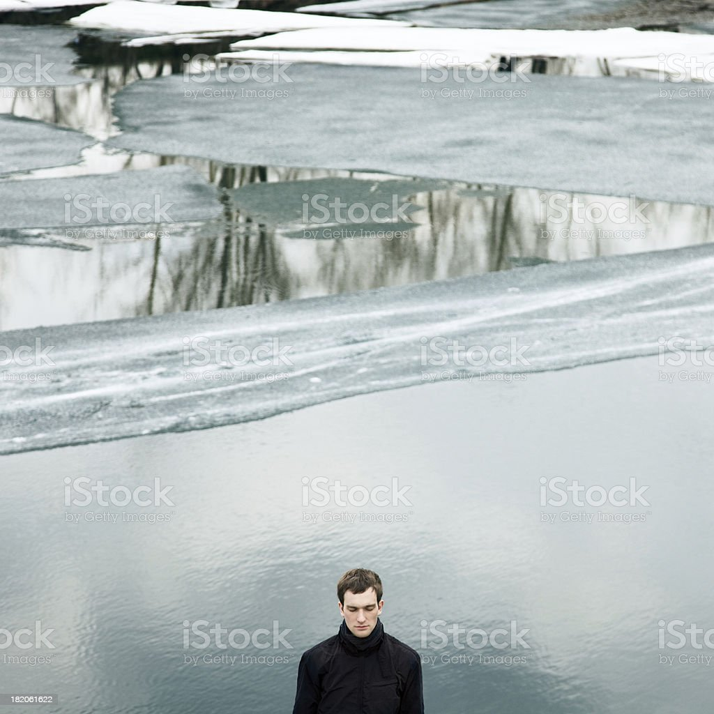 Man against frozen water royalty-free stock photo
