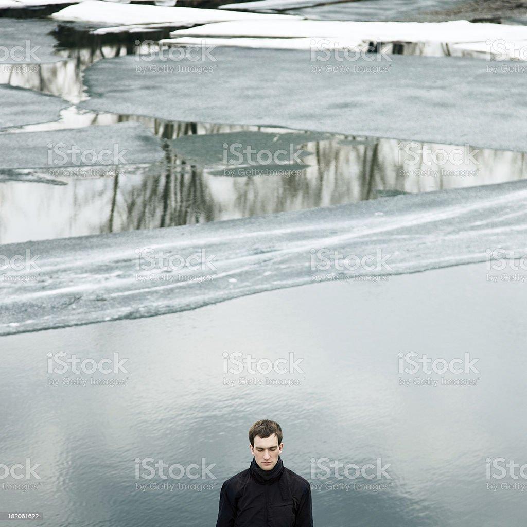 Man against frozen water stock photo