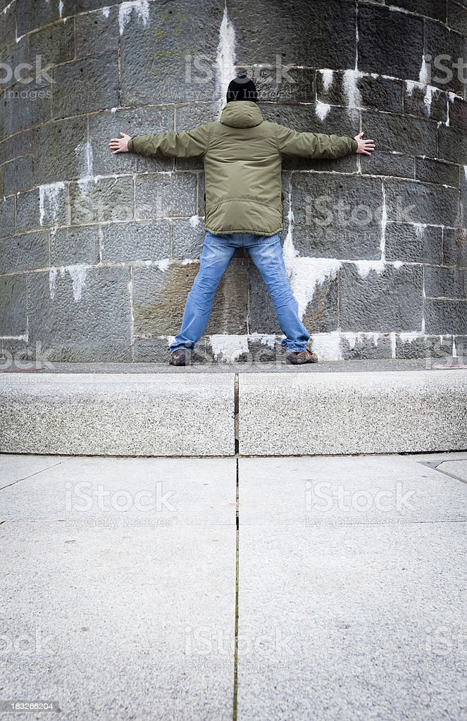 Man against the wall royalty-free stock photo
