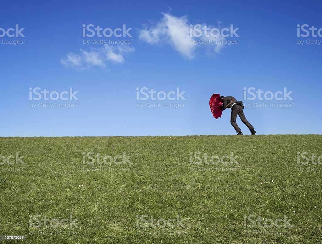 Man against wind royalty-free stock photo