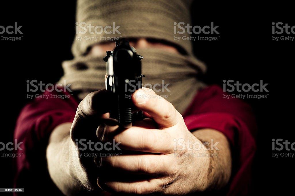 Man aiming a gun at camera royalty-free stock photo