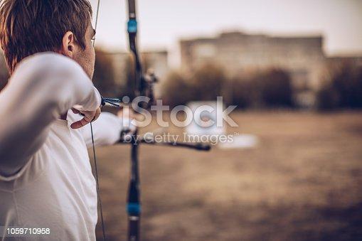 istock Man aiming at target 1059710958