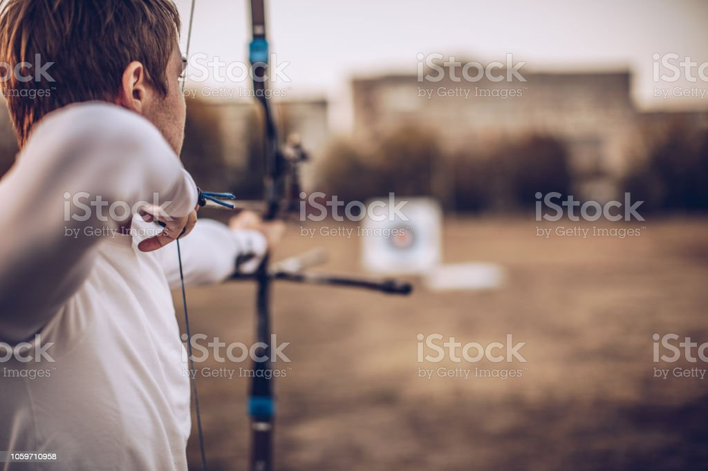 Man aiming at target stock photo