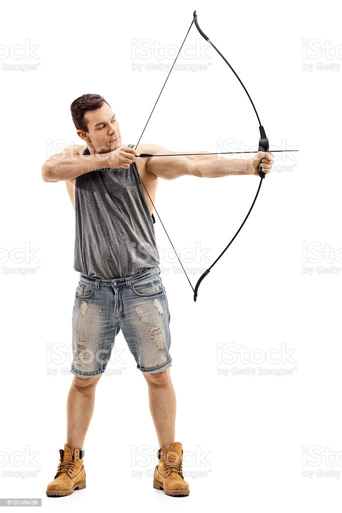Man aiming with a bow and arrow stock photo