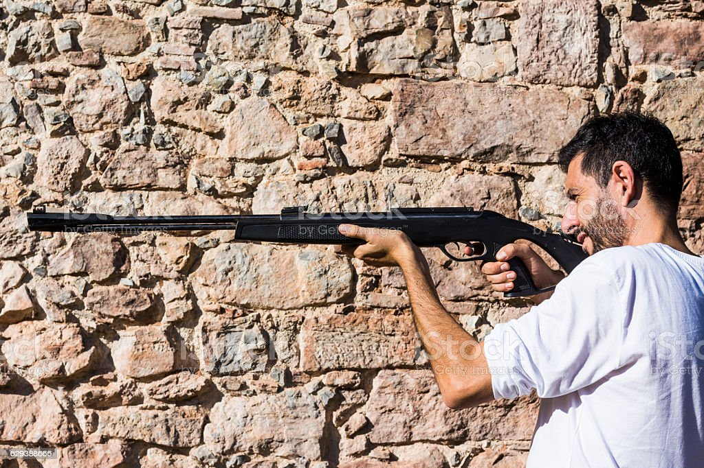 Man aiming with a riffle stock photo