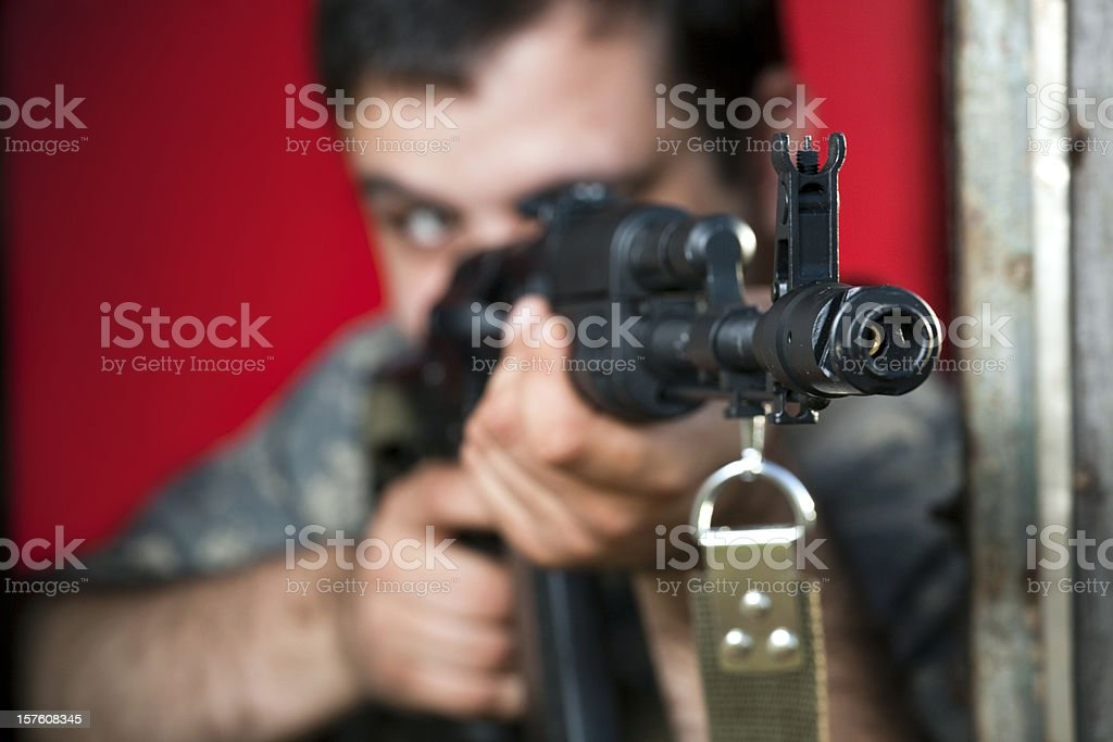 Man aiming with assault rifle AK-47 royalty-free stock photo