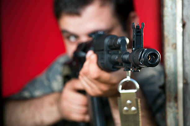Man aiming with assault rifle AK-47 stock photo