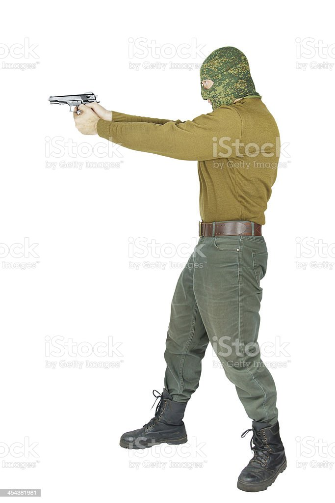 Man aims with a pistol royalty-free stock photo