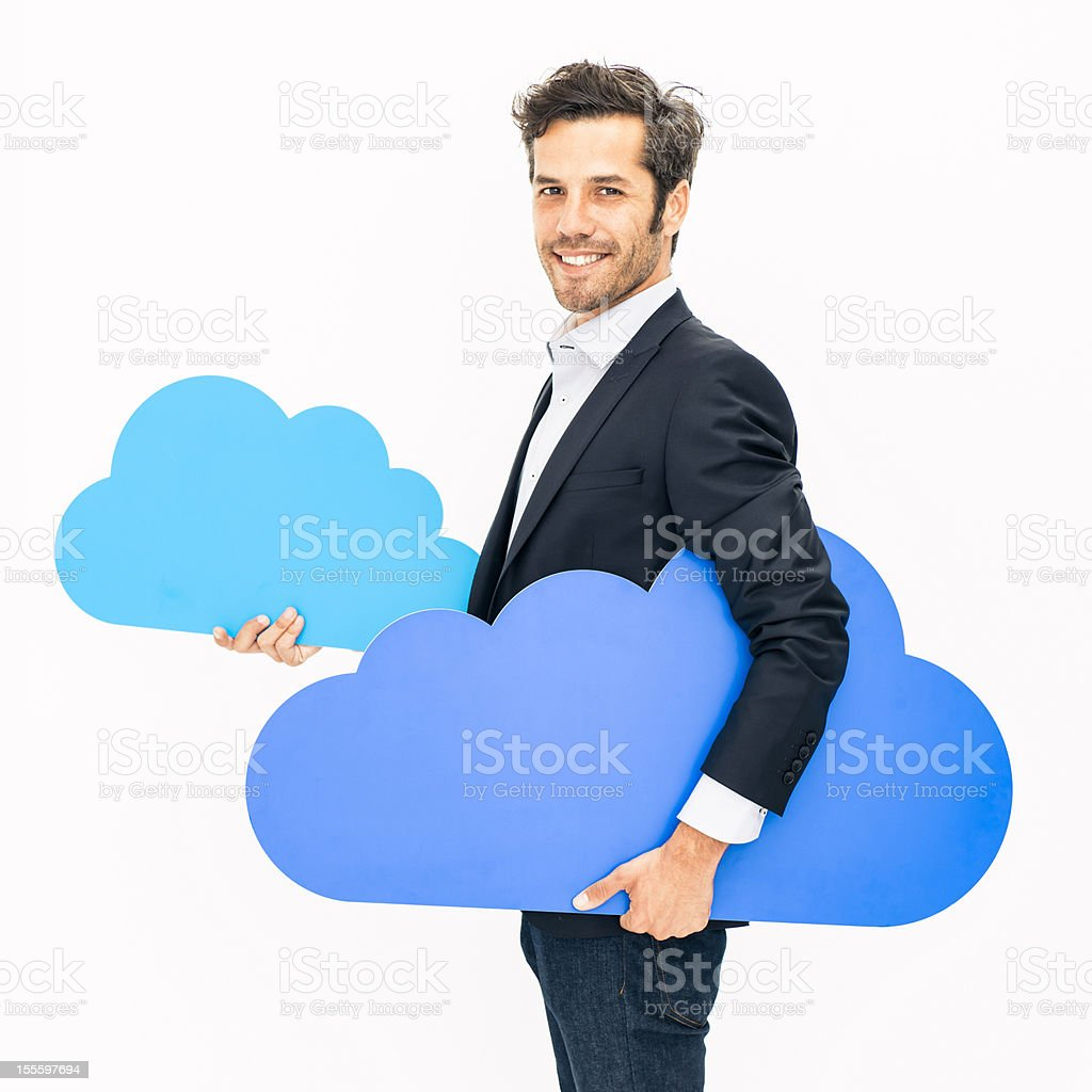 Man among clouds: cloud computing stock photo