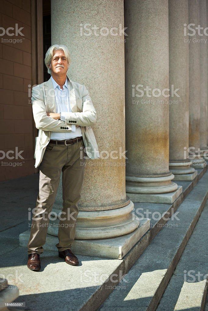 Man among columns royalty-free stock photo