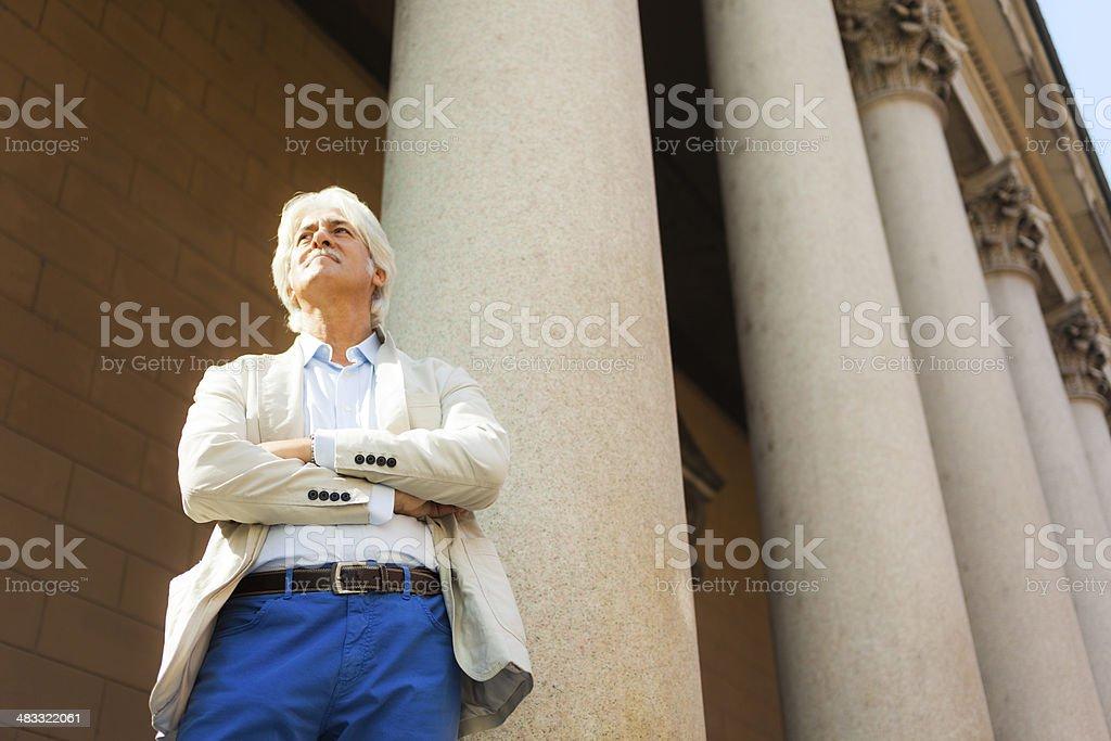 Man among columns stock photo