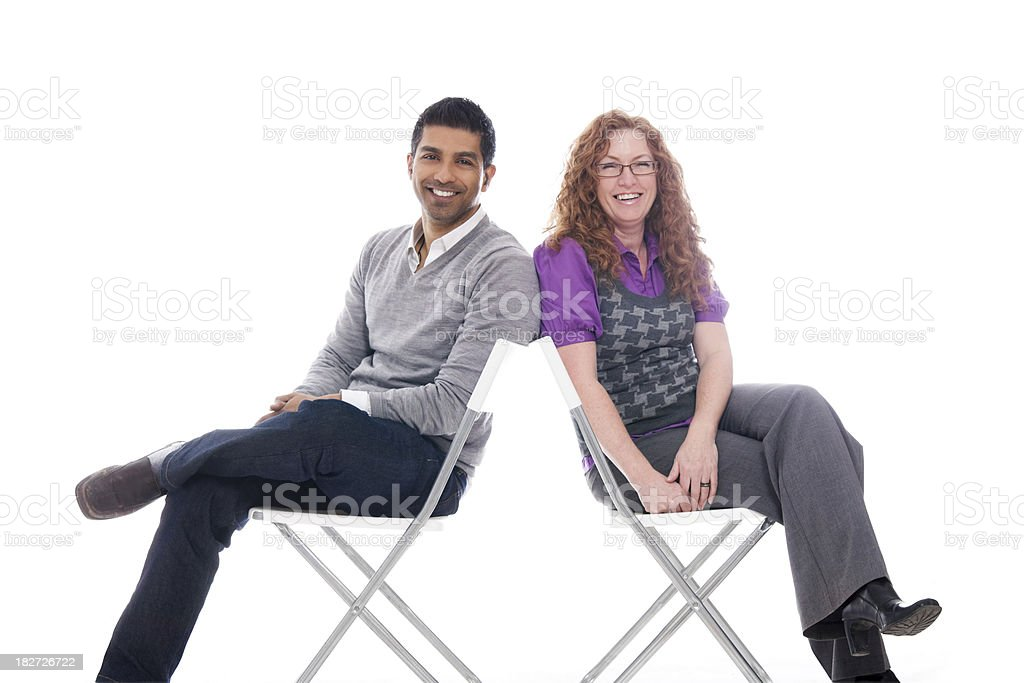 Man & Woman Sitting Back-toBack royalty-free stock photo