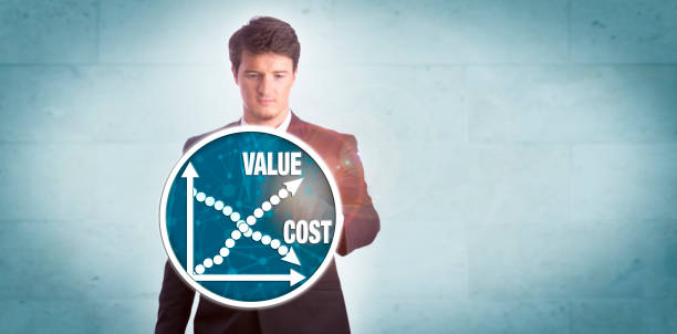Man Analyzing Value Growth Versus Cost Reduction stock photo
