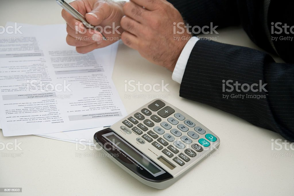A man and a calculator royalty-free stock photo