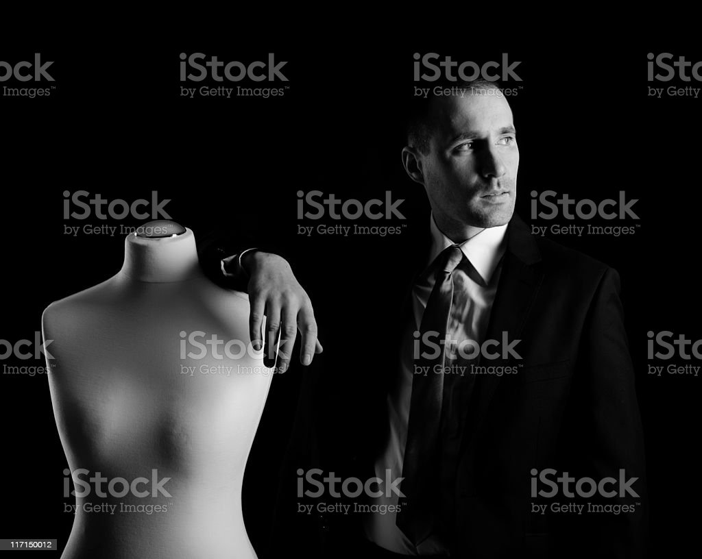man and a sewing mannequin royalty-free stock photo