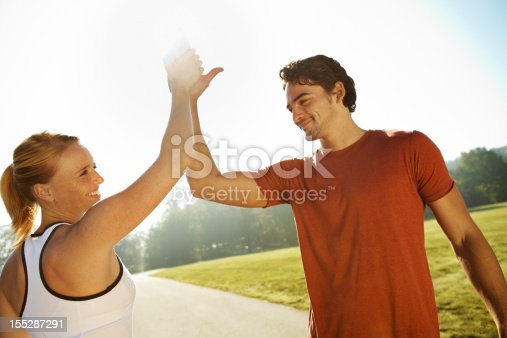 670054434istockphoto A man and a woman celebrating a win 155287291