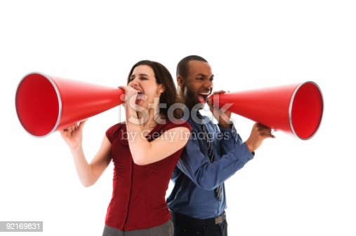 istock A man and a woman each shouting into a megaphone 92169831