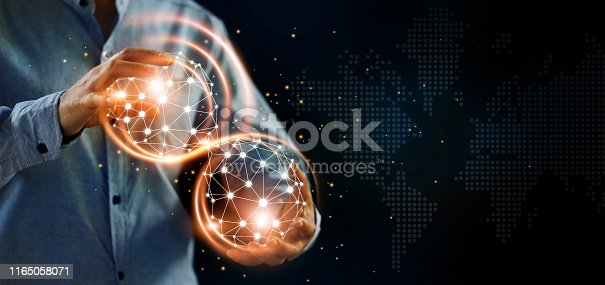 istock Man and abstract global networking connection in hands. Technology and internet communication. Data exchange. 1165058071