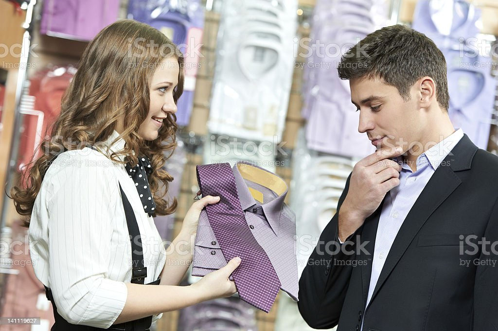man and assistant at apparel clothes shopping stock photo