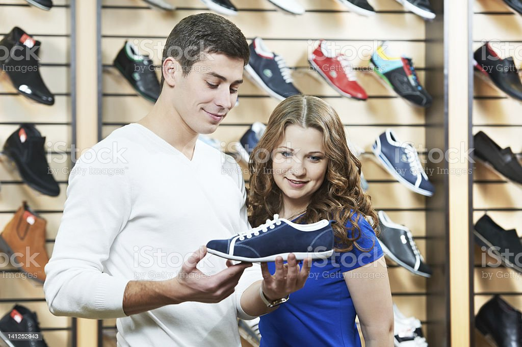 man and assistant at shoe shopping royalty-free stock photo