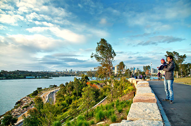 man and baby in barangaroo reserve (new sydney parkland ) - barangaroo stock photos and pictures
