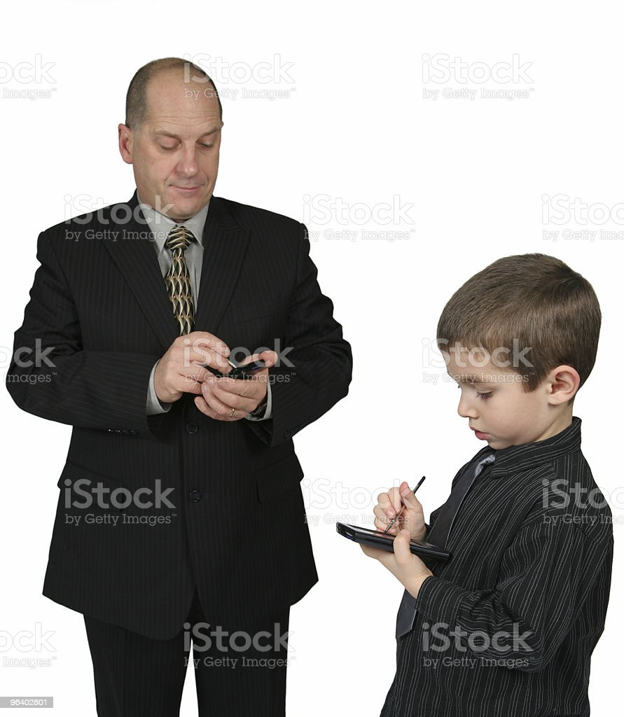 Man and Boy Using PDA - Royalty-free Adult Stock Photo