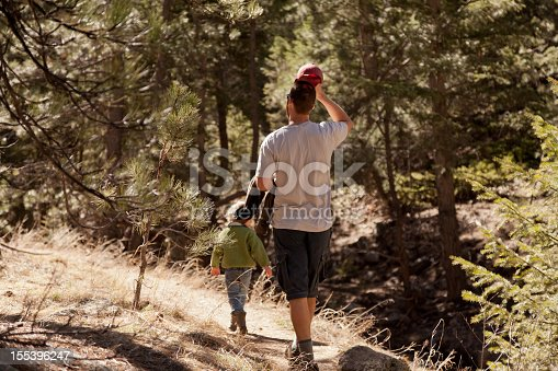 Man and boy on a hike in the pines