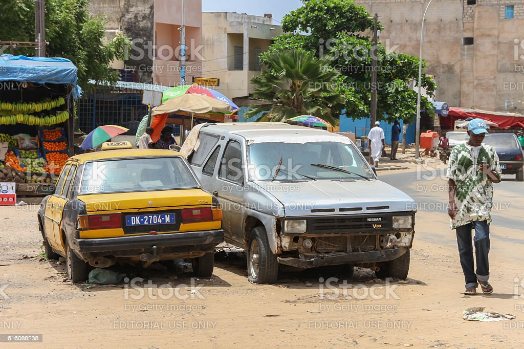 Man And Broken Cars In Dakar In Senegal Stock Photo & More Pictures ...