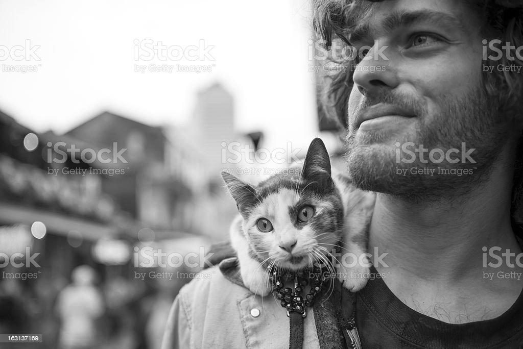 Man and cat at Mardi Gras royalty-free stock photo