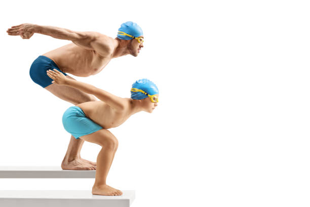 man and child swimmers preparing to jump - jump pool, swimmer imagens e fotografias de stock