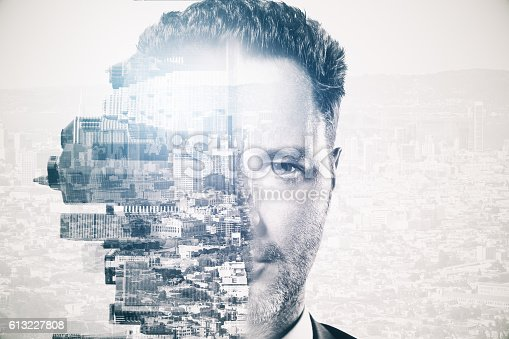istock Man and city on abstract background 613227808