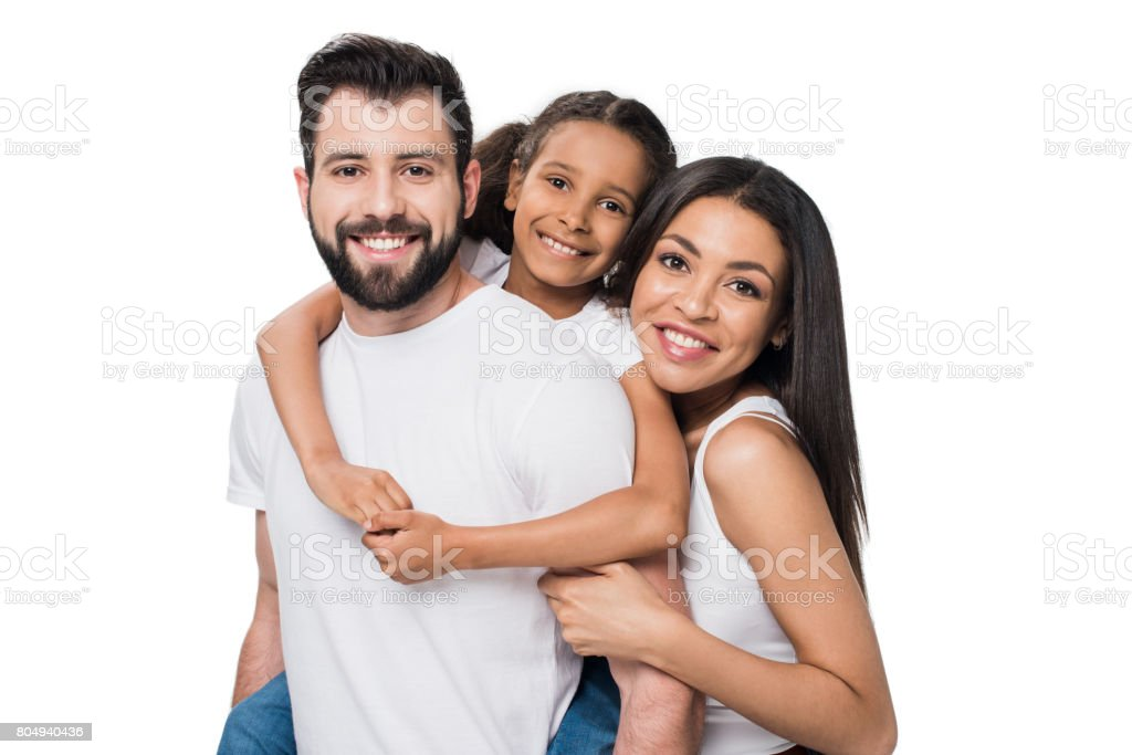 man and daughter piggybacking while woman standing near by isolated on white stock photo