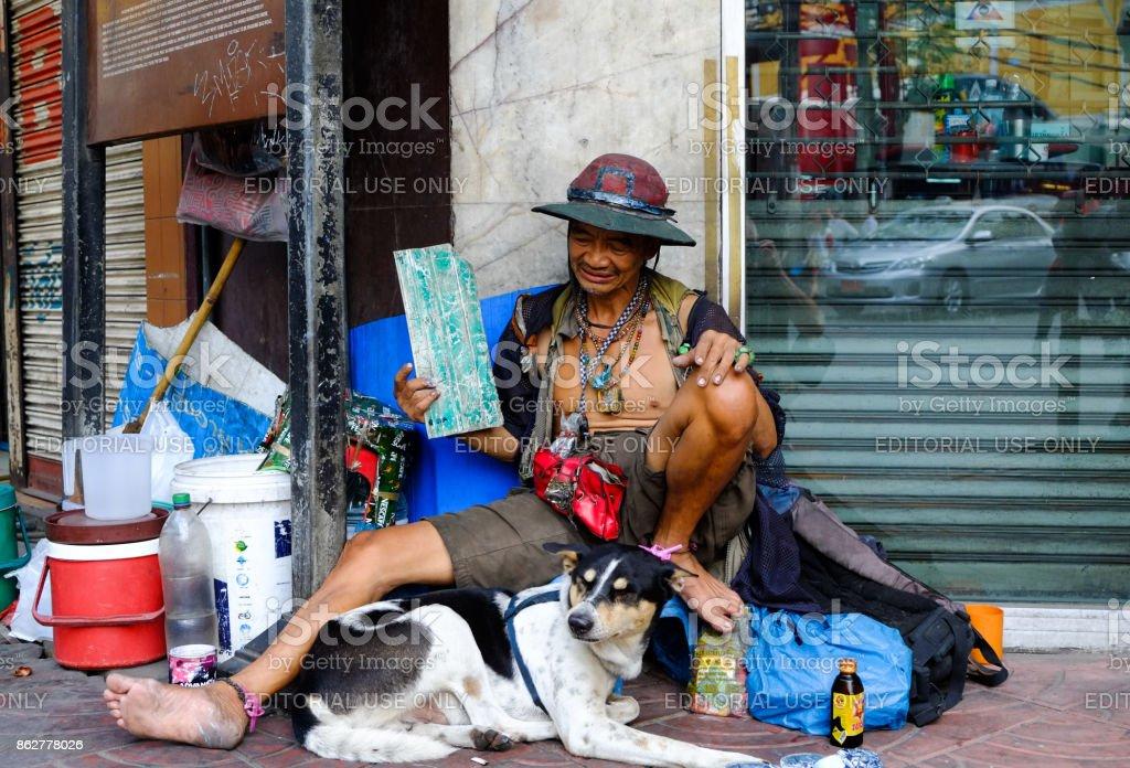 Man and Dog, Bangkok, stock photo
