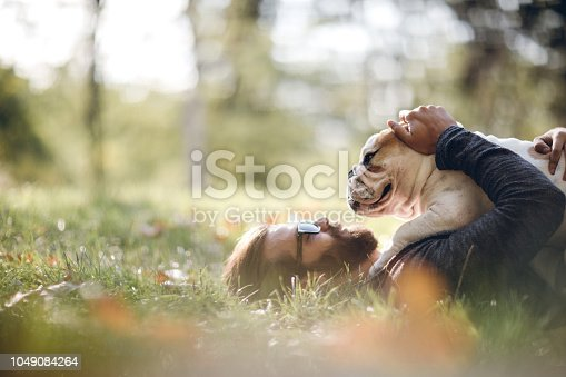 istock Man And Dog Enjoying Sunny Day In Nature 1049084264