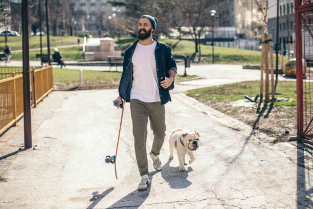 Man and dog in the park picture id934111144?b=1&k=6&m=934111144&s=612x612&w=0&h=hirc8lj8p nikeuuys8rebf644g5zfwya4iz6 3z1o8=