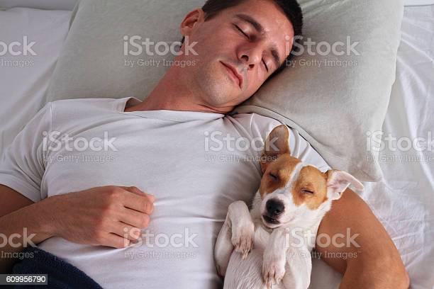 Man and dog sleeping together picture id609956790?b=1&k=6&m=609956790&s=612x612&h=9cnj9qeldjmhg fcavclj b8  2opwypt7nm786lbzc=