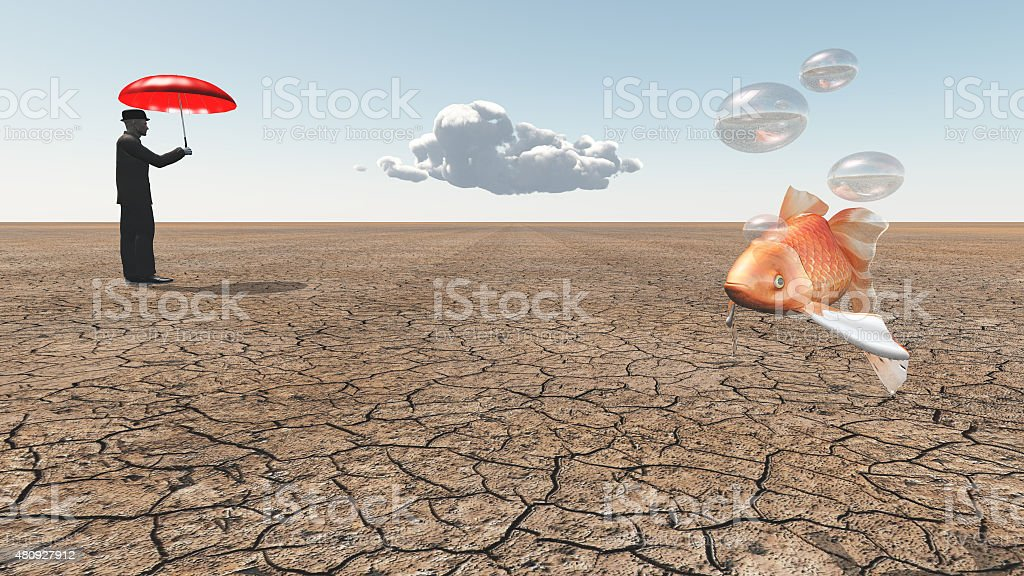Man and floating fish in desert stock photo
