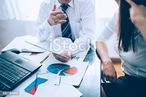 672116416istockphoto Man and girl at the office 532184602