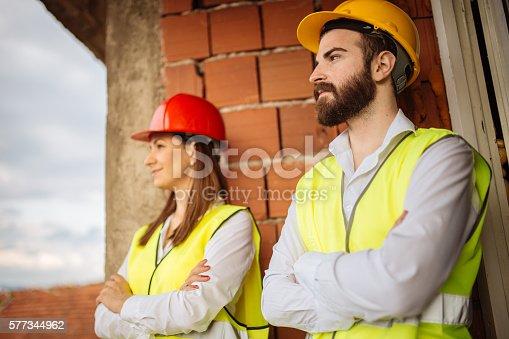 643843490istockphoto Man and girl engineers 577344962